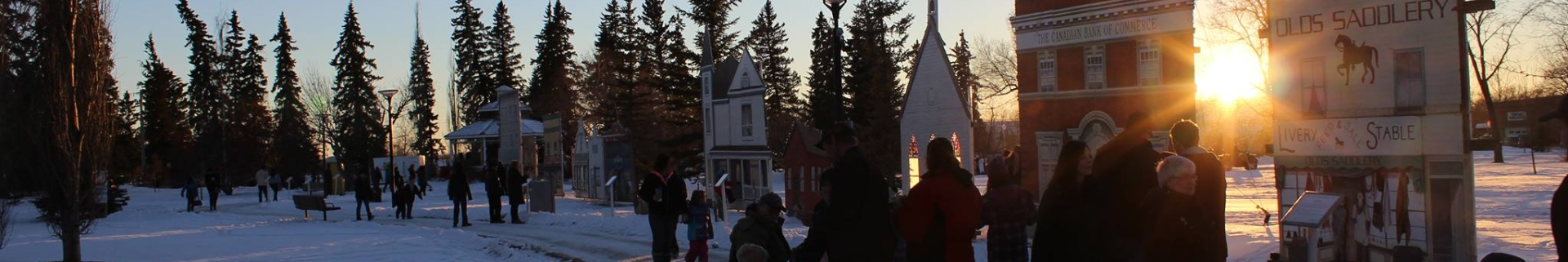 Groups of people enjoying a winter event in the sunset