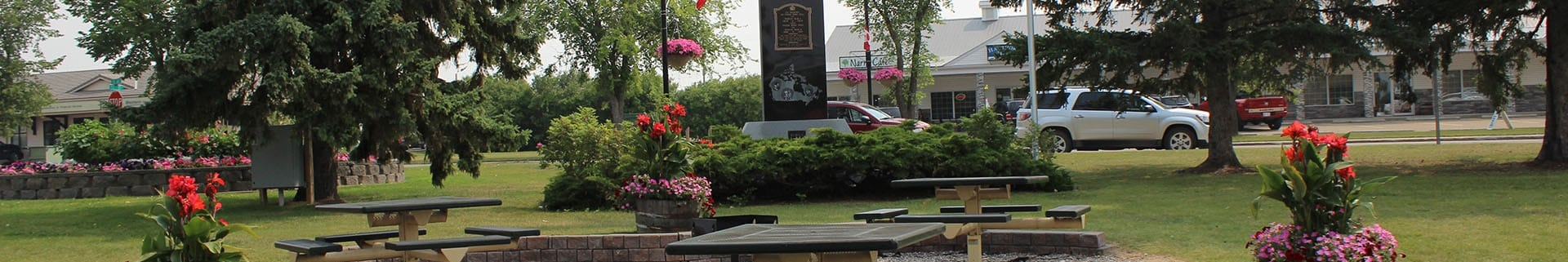 Picnic area with flower pots in Centennial Park in the Town of Olds