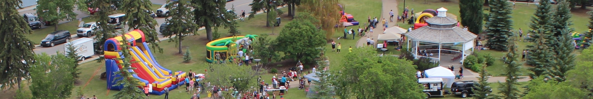 Aerial image of families enjoying Canada Day events in a green space