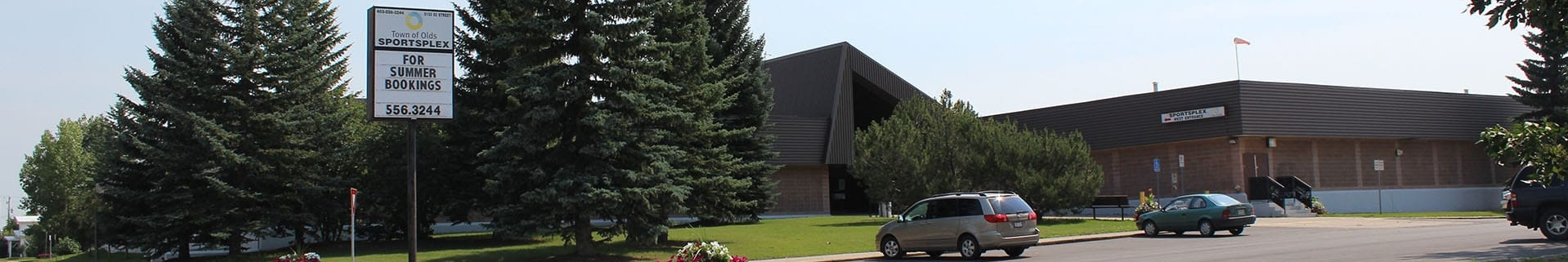 Outside view of the Olds Sportsplex building in the summer
