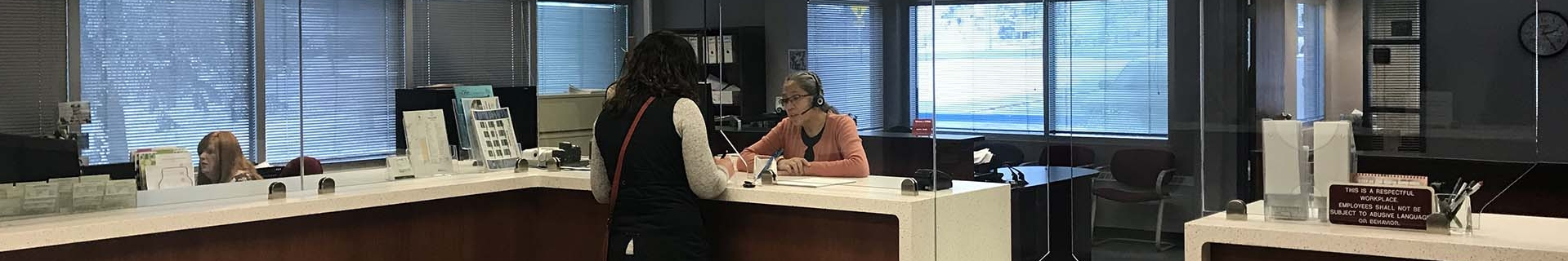 A Town of Olds staff member speaking with another woman in the Town Hall municipal building